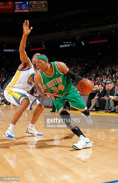 Paul Pierce of the Boston Celtics drives past a Golden State Warriors defender on March 14 2012 at Oracle Arena in Oakland California NOTE TO USER...