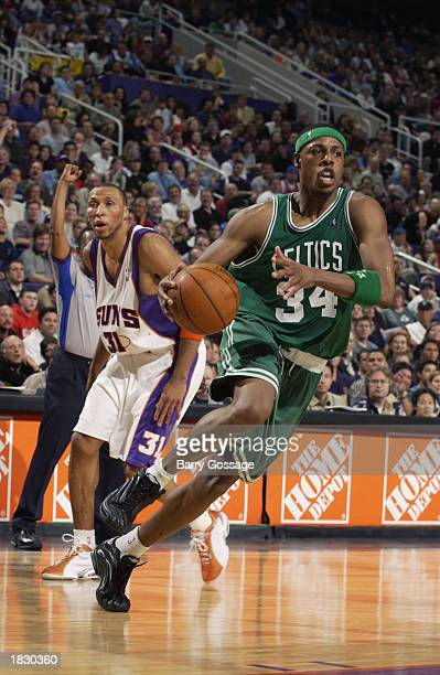 Paul Pierce of the Boston Celtics drives past Shawn Marion of the Phoenix Suns during the game at America West Arena on February 16 2003 in Phoenix...