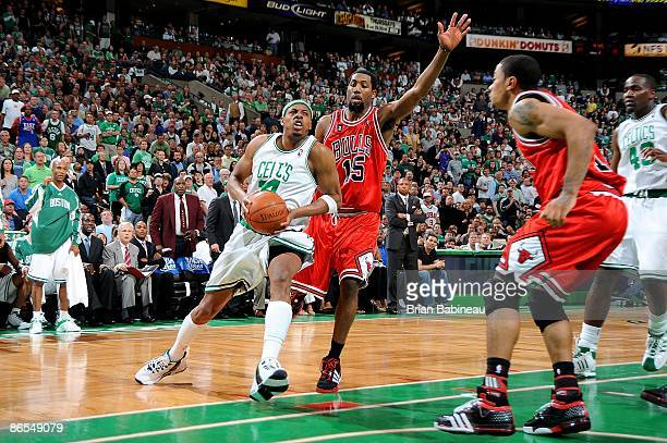 Paul Pierce of the Boston Celtics drives to the basket against John Salmons and Derrick Rose of the Chicago Bulls in Game Seven of the Eastern...