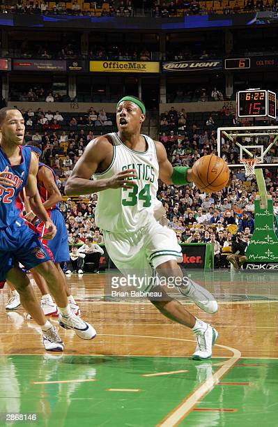 Paul Pierce of the Boston Celtics drives to the hoop by Tayshaun Prince of the Detroit Pistons during the game at the Fleet Center on January 5 2004...