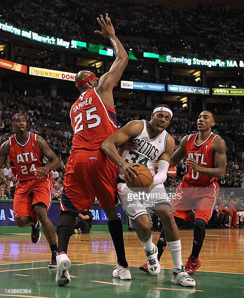 Paul Pierce of the Boston Celtics feels the pressure of Erick Dampier Marvin Williams and Jeff Teague of the Atlanta Hawk in Game Three of the...