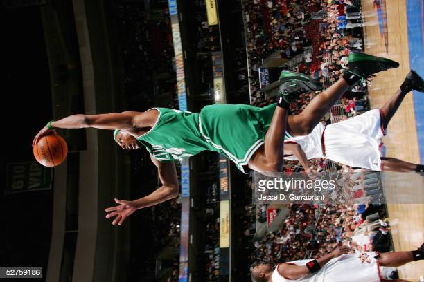 Paul Pierce of the Boston Celtics goes for a dunk against the Philadelphia 76ers during the game on April 12 2005 at the Wachovia Center in...
