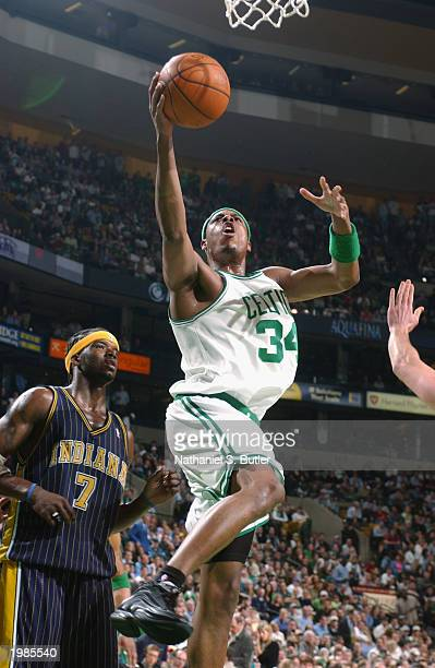 Paul Pierce of the Boston Celtics goes for a layup past Jermaine O'Neal of the Indiana Pacers in Game six of the Eastern Conference Quarterfinals...
