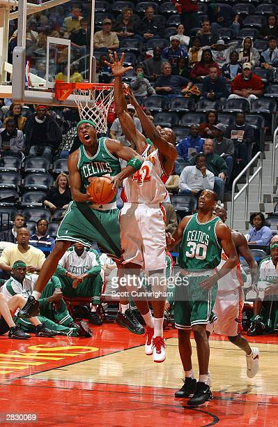 Paul Pierce of the Boston Celtics goes in for a shot against Theo Ratliff of the Atlanta Hawks December 23 2003 at Philips Arena in Atlanta Georgia...