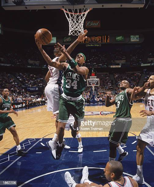 Paul Pierce of the Boston Celtics goes to the basket against Jason Collins of the New Jersey Nets during the NBA game at Continental Airlines Arena...