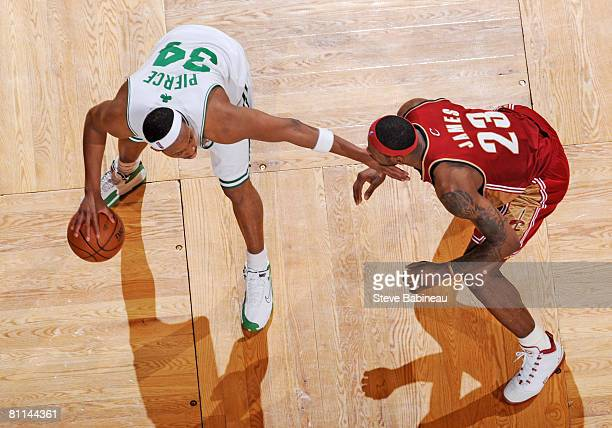 Paul Pierce of the Boston Celtics goes up against Lebron James of the Cleveland Cavaliers in Game Seven of the Eastern Conference Semifinals during...
