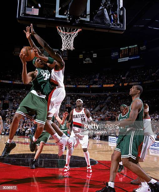 Paul Pierce of the Boston Celtics goes up for a shot against Theo Ratliff of the Portland Trail Blazers during the game at The Rose Garden on...