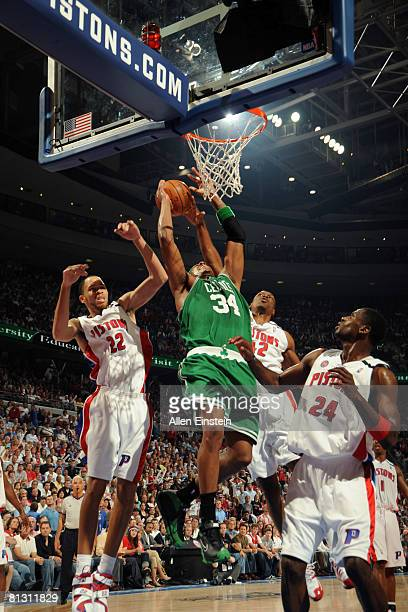 Paul Pierce of the Boston Celtics goes up for a shot attempt between Tayshaun Prince Theo Ratliff and Antonio McDyess of the Detroit Pistons in Game...
