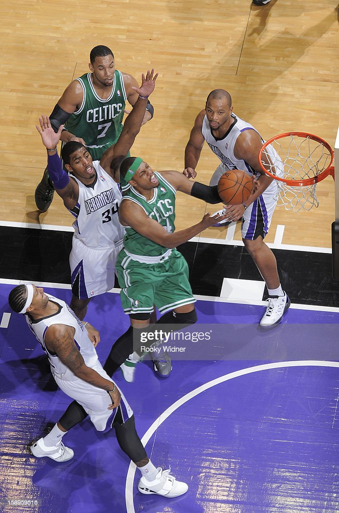 Paul Pierce #34 of the Boston Celtics goes up for the shot against Jason Thompson #34 of the Sacramento Kings on December 30, 2012 at Sleep Train Arena in Sacramento, California.