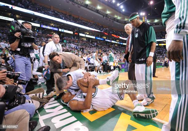 Paul Pierce of the Boston Celtics holds his knee in pain against the Los Angeles Lakers during Game One of the NBA Finals at TD Banknorth Garden on...
