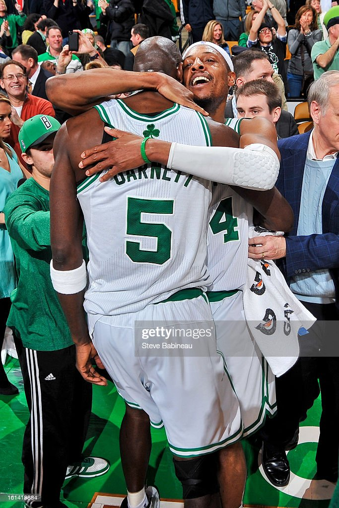Paul Pierce #34 of the Boston Celtics hugs teammate Kevin Garnett #5 after their team's triple overtime victory against the Denver Nuggets on February 10, 2013 at the TD Garden in Boston, Massachusetts.