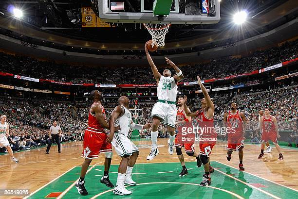 Paul Pierce of the Boston Celtics lays the ball up over Derrick Rose of the Chicago Bulls in Game Seven of the Eastern Conference Quarterfinals...