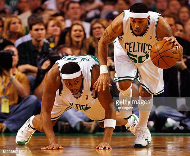 Paul Pierce of the Boston Celtics looks on as Eddie House gains control of the ball against the Detroit Pistons during Game One of the 2008 NBA...