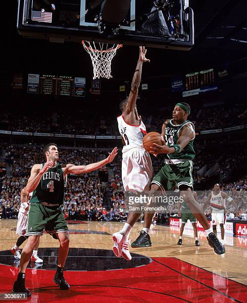 Paul Pierce of the Boston Celtics looks to pass around Theo Ratliff of the Portland Trail Blazers during the game at The Rose Garden on February 21,...