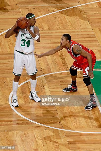 Paul Pierce of the Boston Celtics looks to pass over Derrick Rose of the Chicago Bulls in Game Seven of the Eastern Conference Quarterfinals during...