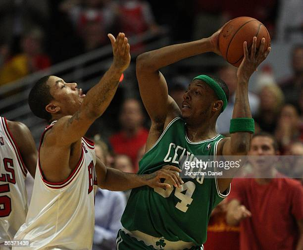 Paul Pierce of the Boston Celtics looks to pass under pressure from Derrick Rose of the Chicago Bulls in Game Six of the Eastern Conference...