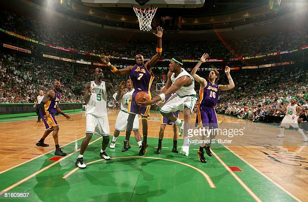 Paul Pierce of the Boston Celtics passes to teammate Kevin Garnett against Lamar Odom and Pau Gasol of the Los Angeles Lakers in Game Six of the 2008...