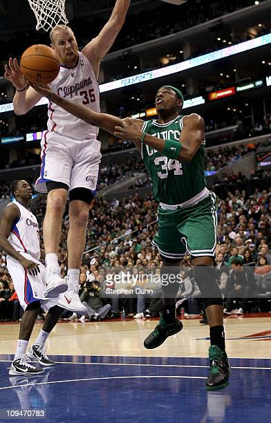 Paul Pierce of the Boston Celtics pus up a shot around Chris Kaman of the Los Angeles Clippers at Staples Center on February 26 2011 in Los Angeles...