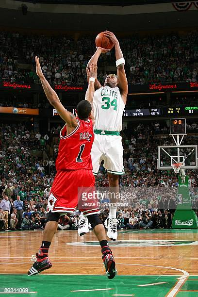 Paul Pierce of the Boston Celtics shoots a jump shot over Derrick Rose of the Chicago Bulls in Game Five of the Eastern Conference Quarterfinals...