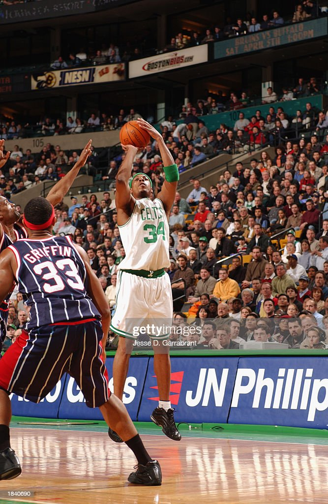 Paul Pierce #34 of the Boston Celtics shoots a jump shot over Eddie Griffin #33 of the Houston Rockets during the NBA game at Fleet Center on February 24, 2003 in Boston, Massachusetts. The Rockets won in overtime 101-95.