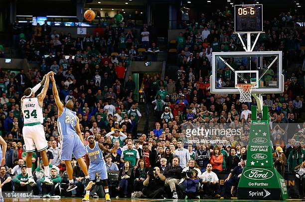 Paul Pierce of the Boston Celtics shoots a threepoint shot to tie the game and take it into a third overtime over Andre Miller of the Denver Nuggets...