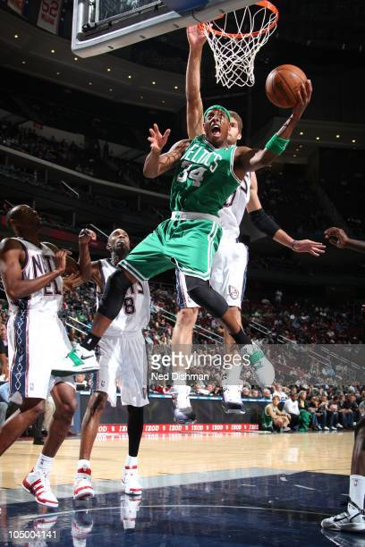 Paul Pierce of the Boston Celtics shoots against Brook Lopez of the New Jersey Nets on October 7 2010 at the Prudential Center in Newark New Jersey...