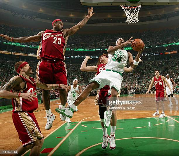 Paul Pierce of the Boston Celtics shoots against Delonte West LeBron James and Anderson Varejao of the Cleveland Cavaliers in Game Seven of the...