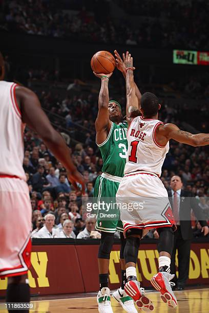 Paul Pierce of the Boston Celtics shoots against Derrick Rose the Chicago Bulls on April 7 2011 at the United Center in Chicago Illinois NOTE TO USER...