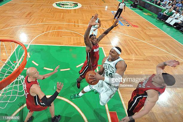 Paul Pierce of the Boston Celtics shoots against LeBron James Zyrdunas Ilgauskas and Mike Bibby of the Miami Heat during Game Three of the Eastern...