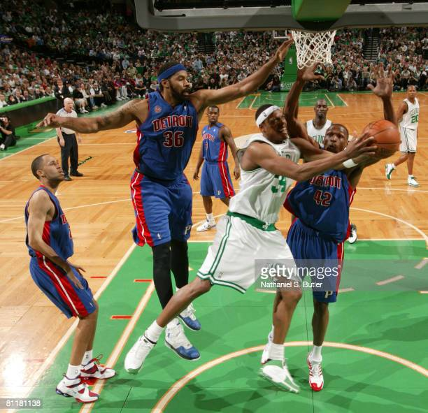 Paul Pierce of the Boston Celtics shoots against Rasheed Wallace and Theo Ratliff of the Detroit Pistons in Game One of the Eastern Conference Finals...