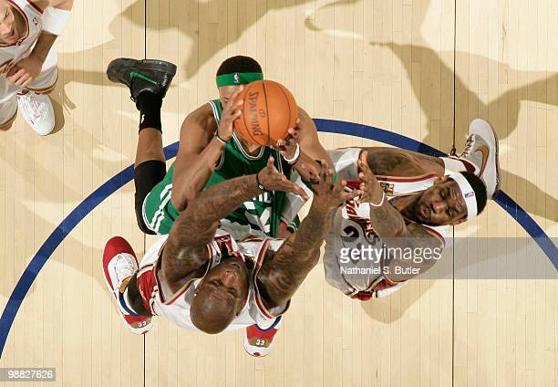 Paul Pierce of the Boston Celtics shoots against Shaquille O'Neal and LeBron James of the Cleveland Cavaliers in Game Two of the Eastern Conference...