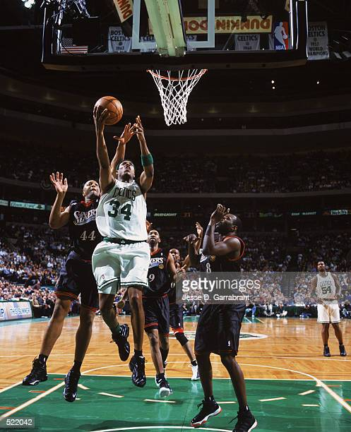 Paul Pierce of the Boston Celtics shoots the ball as Derrick Coleman of the Philadelphia 76ers attempts to block, during game 5 of the Eastern...