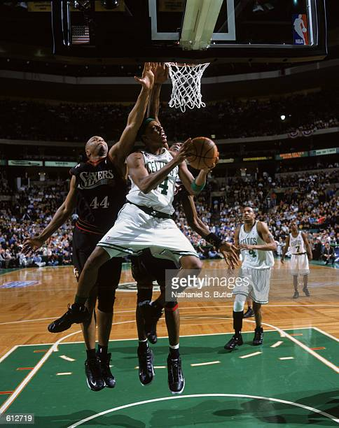 Paul Pierce of the Boston Celtics shoots the ball as Derrick Coleman of the Philadelphia 76ers attempts to block during game 2 of the Eastern...