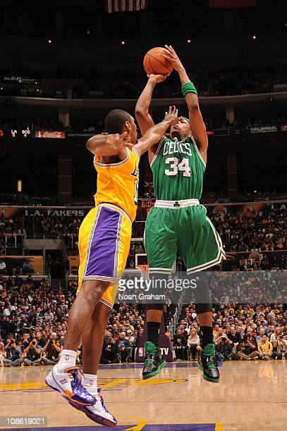 Paul Pierce of the Boston Celtics shoots with a hand in his face from Ron Artest of the Los Angeles Lakers at Staples Center on January 30 2011 in...