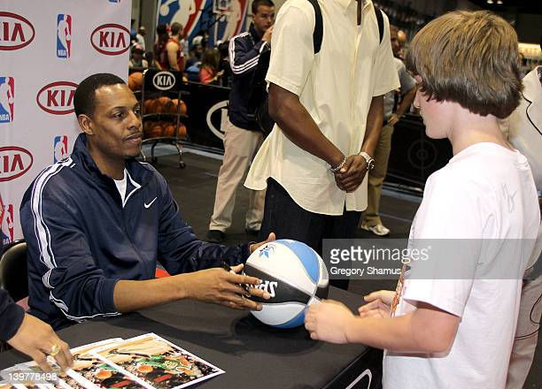 Paul Pierce of the Boston Celtics signs autographs during a appearance at the Kia MVP Court at Jam Session during NBA All Star Weekend on February 24...