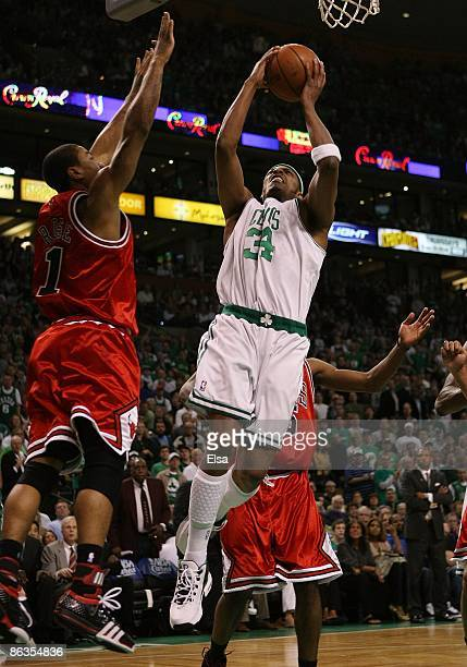 Paul Pierce of the Boston Celtics takes a shot as Derrick Rose of the Chicago Bulls defends in Game Seven of the Eastern Conference Quarterfinals...