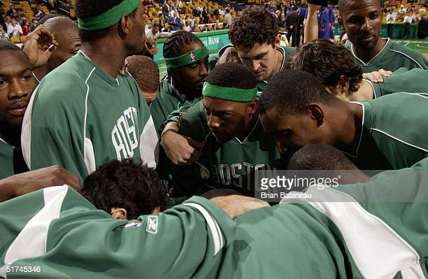 Paul Pierce of the Boston Celtics talks to teammates in a huddle before a preseason game with the Detroit Pistons on October 27 2004 at FleetCenter...