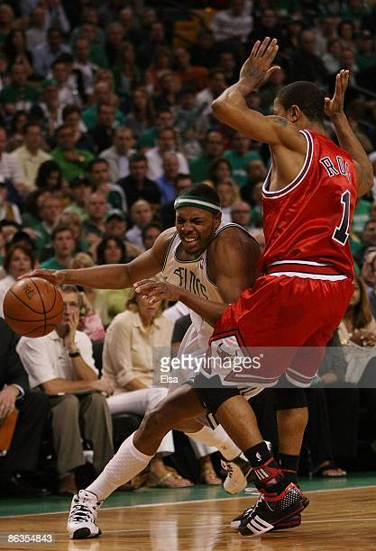 Paul Pierce of the Boston Celtics tries to get around Derrick Rose of the Chicago Bulls in Game Seven of the Eastern Conference Quarterfinals during...