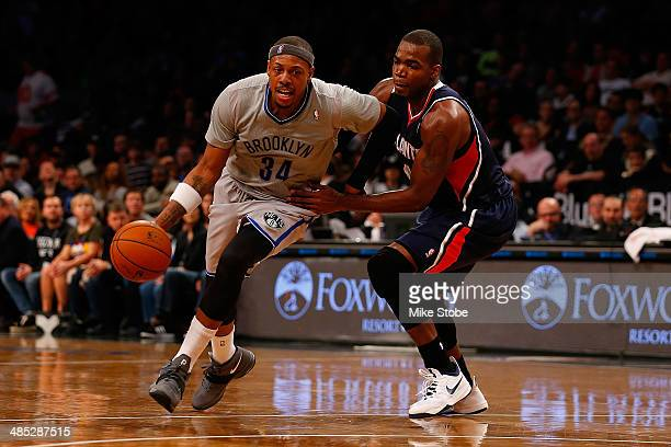 Paul Pierce of the Brooklyn Nets drives towards the net against Paul Millsap of the Atlanta Hawks at Barclays Center on April 11 2014 in New York...