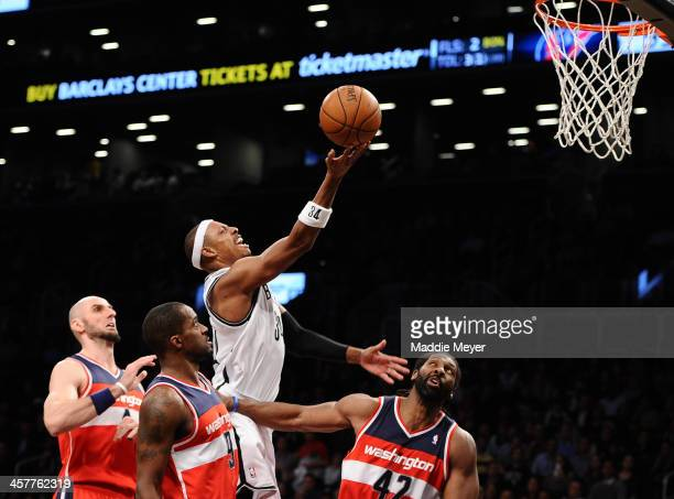 Paul Pierce of the Brooklyn Nets takes a shot over Nene of the Washington Wizards during the second half at Barclays Center on December 18 2013 in...