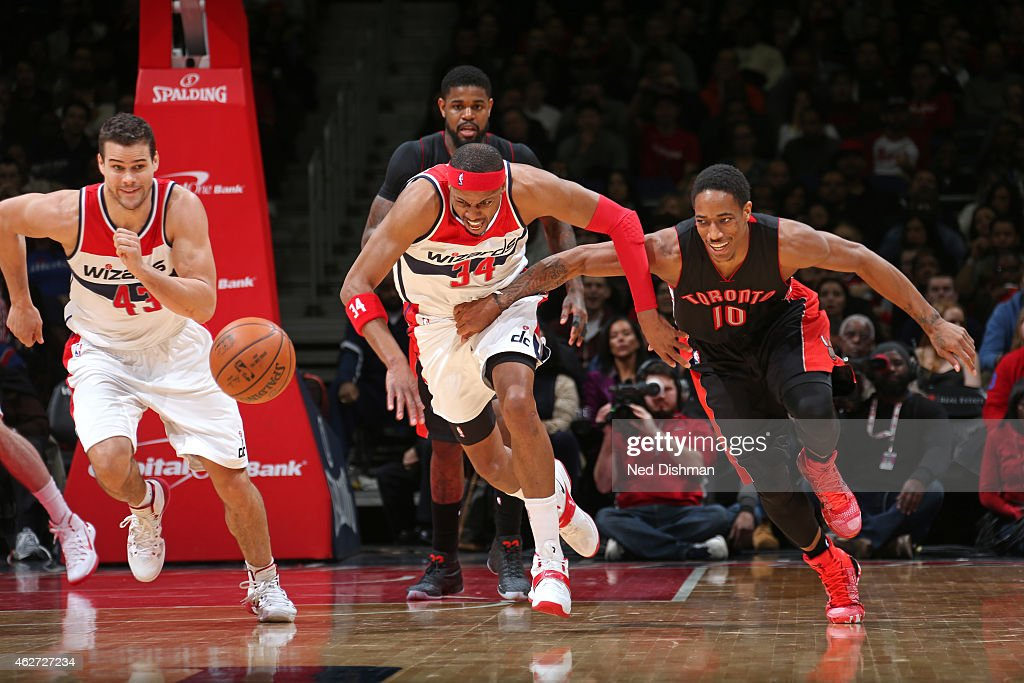 Paul Pierce #34 of the Washington Wizards battles for the loose ball against DeMar DeRozan #10 of the Toronto Raptors on January 31, 2015 at Verizon Center in Washington, DC.