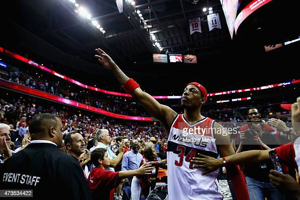 Paul Pierce of the Washington Wizards waves to fans as he leaves the court following the Wizards 94-91 loss to the Atlanta Hawks at Verizon Center on...