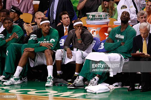 Paul Pierce Rajon Rondo and Kevin Garnett of the Boston Celtics look on from the bench late in the fourth quarter against the Miami Heat in Game Six...