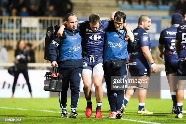 Paul PIMIENTA of Colomiers is helped as he walks off the field after being injured during the Pro D2 match between Colomiers Rugby and RC Vannes on...