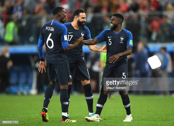 Paul Pogba Adil Rami and Samuel Umtiti of France celebrate victory following the 2018 FIFA World Cup Russia Semi Final match between Belgium and...