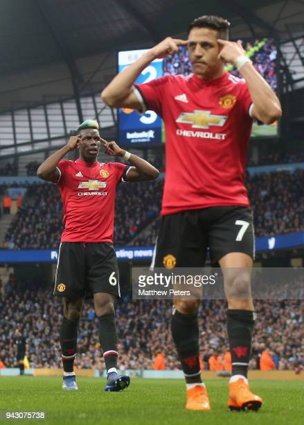 Paul Pogba and Alexis Sanchez of Manchester United celebrate Chris Smalling scoring their third goal during the Premier League match between...