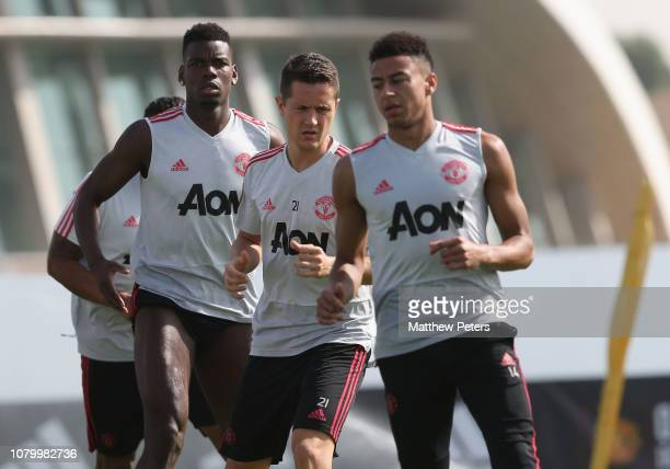 Paul Pogba and Ander Herrera of Manchester United in action during a first team training session at Nad Al Sheba Sports Complex on January 10 2019 in...