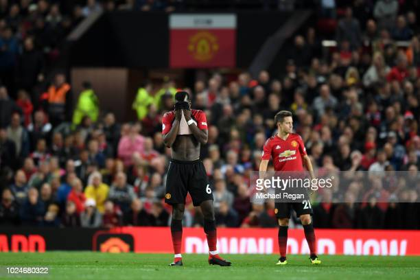 Paul Pogba and Ander Herrera of Manchester United ooks dejected during the Premier League match between Manchester United and Tottenham Hotspur at...