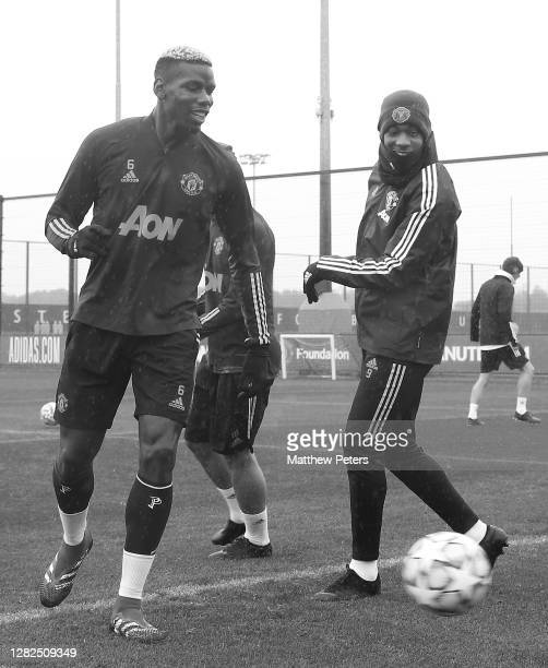 Paul Pogba and Anthony Martial of Manchester United in action during a first team training session ahead of the UEFA Champions League Group H stage...