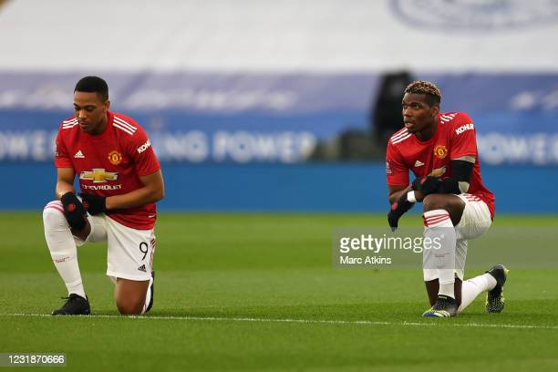 Paul Pogba and Anthony Martial of Manchester United take a knee prior to the Emirates FA Cup Quarter Final match between Leicester City and...